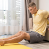 man-working-out-home-using-couch-(1)